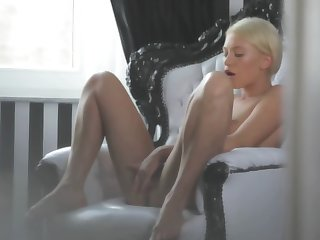 A hot blonde is tweaking her cunt lips with her trotters definitely well
