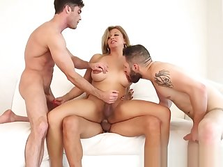 Busty shemale with flowers on her confidential enjoys three cocks