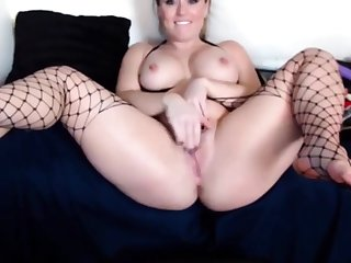Horny red MILF Chrissy with attractive body masturbates