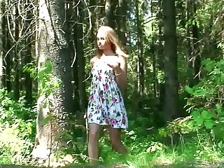 Amateur skinny young chick squats in all directions and pisses in the forest