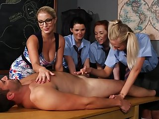 Lucky mendicant lays overhead the table while Candi rides his stiff prick
