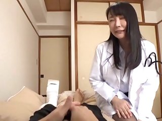 Foxy Japanese girl with stockings enjoys riding a lucky patient