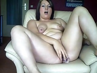 Obese German girl fucks her ass with an increment of pussy with dildos